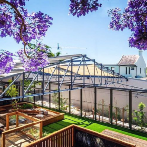 Project: Dulwich Hill Childcare centre. Looking down from the second story you get a sense of the hard work that went into converting this old Sydney warehouse into a functioning childcare centre. Landscape design is on point!