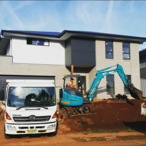 Project: 4 bedroom two storey home @ Greenmeadows, Port Macquarie. Sam our excavator operator working hard to tidy up the front yard to create the best result for our clients on handover.